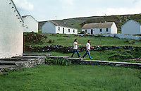 Holiday cottages, Glencolumbkille, Co Donegal, Rep of Ireland, 198009000398a.<br /> <br /> Copyright Image from Victor Patterson, Belfast, UK<br /> <br /> t: +44 28 9066 1296 (from Rep of Ireland 048 9066 1296)<br /> m: +44 7802 353836<br /> e: victorpattersonbelfast@gmail.com<br /> <br /> www.images4media.com<br /> <br /> Please see my full Terms and Conditions of Use at https://www.images4media.com/p/terms-conditions - it is IMPORTANT that you familiarise yourself with them.<br /> <br /> Images used online incur an additional cost. This cost should be agreed in writing in advance. Online images must be visibly watermarked i.e. © Victor Patterson or that of the named photographer within the body of the image. The original metadata must not be deleted from images used online.<br /> <br /> This image is only available for the use of the download recipient i.e. television station, newspaper, magazine, book publisher, etc, and must not be passed on to a third party. It is also downloaded on condition that each and every usage is notified within 7 days to victorpattersonbelfast@gmail.com.<br /> <br /> The right of Victor Patterson (or the named photographer) to be identified as the author is asserted in accordance with The Copyright Designs And Patents Act (1988). All moral rights are asserted.
