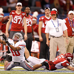 January 4, 2011; New Orleans, LA, USA;  Ohio State Buckeyes wide receiver Corey Brown (10) reaches for the ball after colliding with Arkansas Razorbacks cornerback Isaac Madison (6) during the second quarter of the 2011 Sugar Bowl at the Louisiana Superdome.  Mandatory Credit: Derick E. Hingle