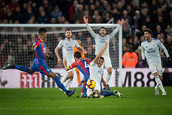 Crystal Palace's Luka Milivojevic (left) and Cardiff City's Lee Peltier battle for the ball