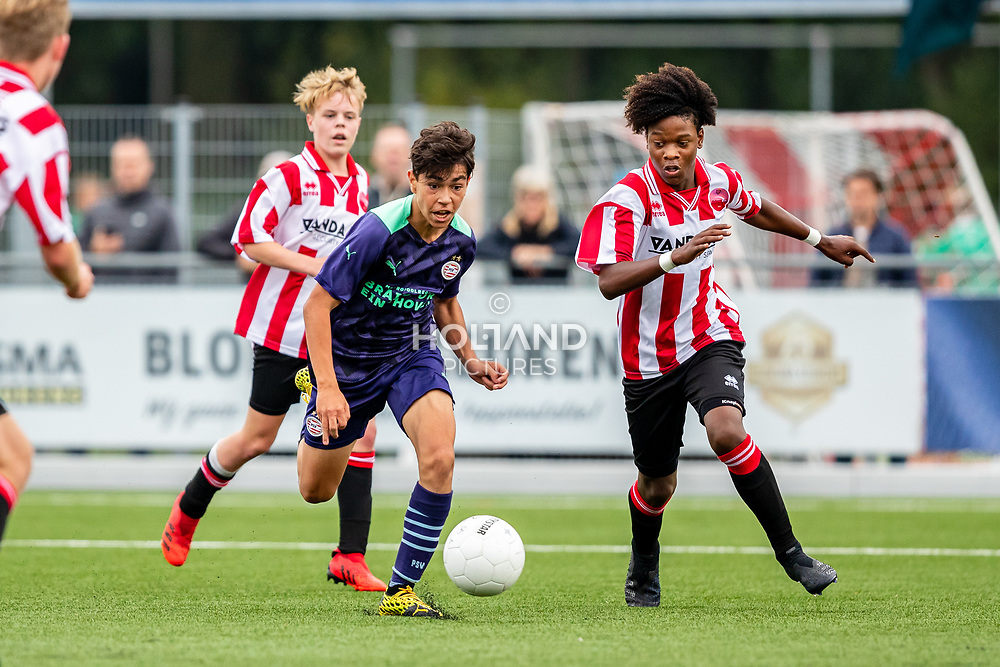 ALPHEN AAN DEN RIJN, NETHERLANDS - OCTOBER 2: (L-R) #6 Benjamin Khaderi (PSV), #3 D'Angelo Lobman (Alphense Boys) during the Divisie 1 A NAJAAR u15 match between Alphense Boys and PSV at Sportpark De Bijlen on October 2, 2021 in Alphen aan den Rijn, Netherlands