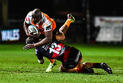 Cheetahs' Teboho Mohoje is tackled by Dragons' Sam Beard<br /> <br /> Photographer Craig Thomas/Replay Images<br /> <br /> Guinness PRO14 Round 18 - Dragons v Cheetahs - Friday 23rd March 2018 - Rodney Parade - Newport<br /> <br /> World Copyright © Replay Images . All rights reserved. info@replayimages.co.uk - http://replayimages.co.uk