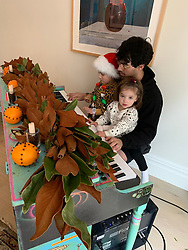 """Joe Jonas releases a photo on Twitter with the following caption: """"""""The girls teaching uncle Joe some tunes 🎹"""""""". Photo Credit: Twitter *** No USA Distribution *** For Editorial Use Only *** Not to be Published in Books or Photo Books ***  Please note: Fees charged by the agency are for the agency's services only, and do not, nor are they intended to, convey to the user any ownership of Copyright or License in the material. The agency does not claim any ownership including but not limited to Copyright or License in the attached material. By publishing this material you expressly agree to indemnify and to hold the agency and its directors, shareholders and employees harmless from any loss, claims, damages, demands, expenses (including legal fees), or any causes of action or allegation against the agency arising out of or connected in any way with publication of the material."""