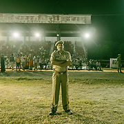A policeman guarding the crowd. People celebrating Dussehra in Chittorgarh. Dussehra is a Hindu celebration and signifies the day of the victory of truth and justice when Lord Rama was successful in killing the demon king Ravana in the famous Indian epic of Ramayana.