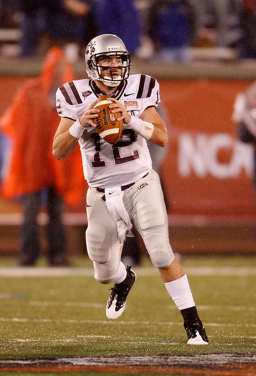 CHATTANOOGA, TN - DECEMBER 18:  Quarterback Andrew Selle #12 of the Montana Grizzlies drops back to pass during the NCAA FCS Championship game against the Villanova Wildcats at Finley Stadium on December 18, 2009 in Chattanooga, Tennessee.  The Wildcats beat the Grizzlies 23-21.  (Photo by Mike Zarrilli/Getty Images)