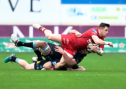 Scarlets' Steff Evans is tackled by Glasgow Warriors' Callum Gibbins<br /> <br /> Photographer Simon King/Replay Images<br /> <br /> Guinness PRO14 Round 19 - Scarlets v Glasgow Warriors - Saturday 7th April 2018 - Parc Y Scarlets - Llanelli<br /> <br /> World Copyright © Replay Images . All rights reserved. info@replayimages.co.uk - http://replayimages.co.uk