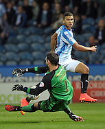 Nahki Wells of Huddersfield Town is denyed by Scott Carson of Wigan Athletic during the Sky Bet Championship match at the John Smiths Stadium, Huddersfield<br /> Picture by Graham Crowther/Focus Images Ltd +44 7763 140036<br /> 16/09/2014