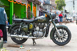 Royal Enfield Bullet at a rest stop on Motorcycle Sherpa's Ride to the Heavens motorcycle adventure in the Himalayas of Nepal. On the second day of riding, we went from Nuwakot to Pokhara. Tuesday, November 5, 2019. Photography ©2019 Michael Lichter.