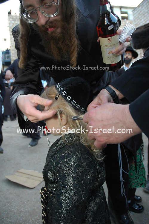 Israel, Galilee, Mount Meron, Jews praying during the lag b'omer celebrations at mount Meron. Lag B'Omer is a day for bonfire celebrations. The most famous is held at the village of Meron, near the northern city of Safed. May 2005 Traditional first haircut at the age of four