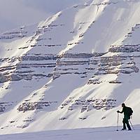 An expedition skier crosses Tunabreen Glacier on Spitsbergen Island