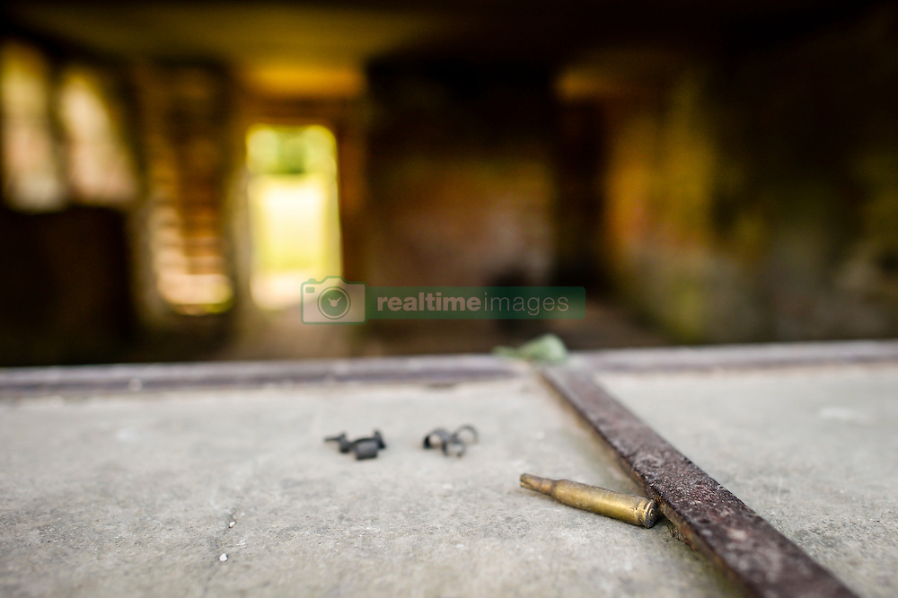 Blank fired ammunition and belt clips on a window frame in a building at Seagram's Farm in Imber village on Salisbury Plain, Wiltshire, where residents were evicted in 1943 to provide an exercise area for US troops preparing to invade Europe. Roads through the MoD controlled village are now open and will close again on Monday August 22.