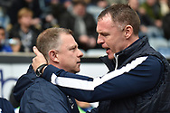 Coventry City manager Mark Robins  greets Bristol Rovers manager Graham Coughlan during the EFL Sky Bet League 1 match between Coventry City and Bristol Rovers at the Ricoh Arena, Coventry, England on 7 April 2019.