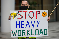 London, UK. 5th August, 2021. A night-shift cleaner belonging to the Cleaners and Allied Independent Workers Union (CAIWU) protests outside the UK headquarters of Facebook. Cleaners are outsourced via the Churchill group to clean the Facebook offices and CAIWU claims that five additional floors have been added to their workload, that cleaners who have left have not been replaced and that sickness and holiday cover has not been provided.
