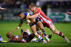 Bath Full Back (#15) Anthony Watson is tackled by Gloucester Flanker (#7) Matt Kvesic during the first half of the match - Photo mandatory by-line: Rogan Thomson/JMP - Tel: 07966 386802 - 25/10/2013 - SPORT - RUGBY UNION - The Recreation Ground, Bath - Bath Rugby v Gloucester Rugby - Aviva Premiership.