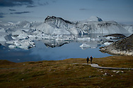 """Here is a description of Ilulissat Icefjord from UNESCO World Heritage List:<br /> """"Located on the west coast of Greenland, 250 km north of the Arctic Circle, Greenland's Ilulissat Icefjord (40,240 ha) is the sea mouth of Sermeq Kujalleq, one of the few glaciers through which the Greenland ice cap reaches the sea. Sermeq Kujalleq is one of the fastest (19 m per day) and most active glaciers in the world. It annually calves over 35 km3 of ice, i.e. 10% of the production of all Greenland calf ice and more than any other glacier outside Antarctica. Studied for over 250 years, it has helped to develop our understanding of climate change and icecap glaciology. The combination of a huge ice-sheet and the dramatic sounds of a fast-moving glacial ice-stream calving into a fjord covered by icebergs makes for a dramatic and awe-inspiring natural phenomenon."""""""