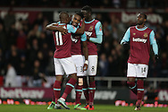 Michail Antonio of West Ham United © celebrates with his teammates after he scores his teams 1st goal.  The Emirates FA cup, 4th round replay match, West Ham Utd v Liverpool at the Boleyn Ground, Upton Park  in London on Tuesday 9th February 2016.<br /> pic by John Patrick Fletcher, Andrew Orchard sports photography.