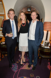 Left to right, DAVID TOLLEMACHE, DAISY FANE and ARCHIE NORMAN at an exclusive dinner for Iris Apfel held at Annabel's, Berkeley Square, London on 29th July 2015.