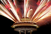 Fireworks shoot from the Space Needle at midnight on New Year's Eve in Seattle.<br /> Ken Lambert / The Seattle Times