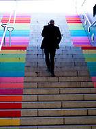 Man in a suit walking up the stairs