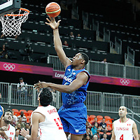 04 August 2012: France Kevin Seraphin goes for the layup during 73-69 Team France victory over Team Tunisia, during the men's basketball preliminary, at the Basketball Arena, in London, Great Britain.