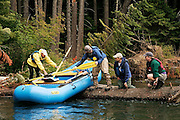 USGS and NOAA fisheries biologists navigate a logjam during a rafting survey of the Yakima River near Cle Elum, Washington on August 20, 2007.