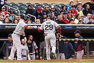 Daniel Nava #29 of the Boston Red Sox is congratulated in the dugout after scoring against the Minnesota Twins on May 17, 2013 at Target Field in Minneapolis, Minnesota.  The Red Sox defeated the Twins 3 to 2.  Photo: Ben Krause