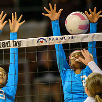 111414  Adron Gardner/Independent<br /> <br /> Navajo Prep Eagles XXX (9), left, and XXX (2) attempt to block a Tularosa Wildcat spike during the New Mexico state volleyball quarterfinals at the Santa Ana Star Center in Rio Rancho Friday.