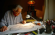 "The renowned maze designer Randoll Coate works in his studio on more labyrinth plans. Gilbert Randoll Coate (8 October 1909 – 2 December 2005) was a British diplomat, maze designer and ""labyrinthologist"". With interests in art and history, Coate completed over 50 new mazes in Britain and around the world. His designs are particularly noted for their symbolism. Although it is rarely possible to see a large maze in plan view, they would often incorporate hidden shapes and references of significance to the clients who had commissioned the maze. Notable work includes: Bath Festival Maze (1984) — a stone path in Beazer Gardens, Bath; a yew hedge maze at Blenheim Palace for the Duke of Marlborough; El laberinto de Borges (Borges Memorial Maze) — San Rafael, Mendoza, Argentina. He died in Le Rouret, near Grasse, France on the 2 December 2005, aged 96."