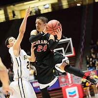 031214  Adron Gardner/Independent<br /> <br /> Grants Pirate XXX () St. Pius X Sartan XXX () during the state high school basketball tournament at The Pit in Albuquerque Tuesday.