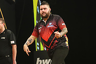 Michael Smith hits a double and celebrates during the Grand Slam of Darts 2018 at Aldersley Leisure Village, Wolverhampton, United Kingdom on 15 November 2018.