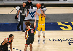 Jan 25, 2021; Morgantown, West Virginia, USA; West Virginia Mountaineers guard Jordan McCabe (5) shoots a three pointer during the first half against the Texas Tech Red Raiders at WVU Coliseum. Mandatory Credit: Ben Queen-USA TODAY Sports