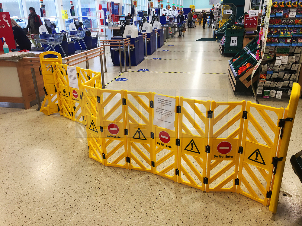 © Licensed to London News Pictures. 30/03/2020. Llandrindod Wells, Powys, Wales, UK. A one way system is set out at Tesco supermarket, Llandrindod Wells in Powys, Wales, UK. in line with the social-distancing guidelines set by the government, whilst the 'lockdown' is in place for Covid-19 virus. Photo credit: Graham M. Lawrence/LNP