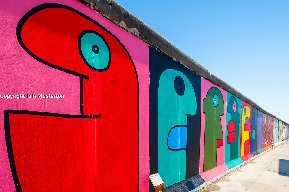 Colourful murals painted on wall at East Side Gallery at former Berlin Wall in Friedrichshain/Kreuzberg in Berlin Germany