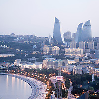 Baku, Azerbaijan, 23 July 201<br /> View of Baku at sunset.<br /> Baku is the capital and largest city of Azerbaijan, as well as the largest city on the Caspian Sea and of the Caucasus region. <br /> It is located on the southern shore of the Absheron Peninsula, which projects into the Caspian Sea. <br /> The city consists of two principal parts: the downtown and the old Inner City (21.5 ha). <br /> Baku's urban population at the beginning of 2009 was estimated at just over two million people. Officially, about 25 percent of all inhabitants of the country live in the metropolitan city area of Baku.<br /> Photo: Ezequiel Scagnetti