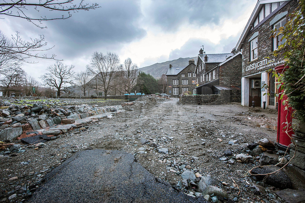 © Licensed to London News Pictures. 18/03/2016. Cumbria UK. File picture shows a road in Glenridding damaged by storms last December. The Department for Transport has pledged an additional £82.6m today to fund essential repairs to infrastructure in Cumbria damaged by Storms Desmond & Eva last December. Photo credit: Andrew McCaren/LNP
