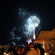 Patrons at Galley Beach beachside restaurant, watch a nearby firework display. Nantucket, Nantucket Island, Massachusetts, USA. Photo Tim Clayton