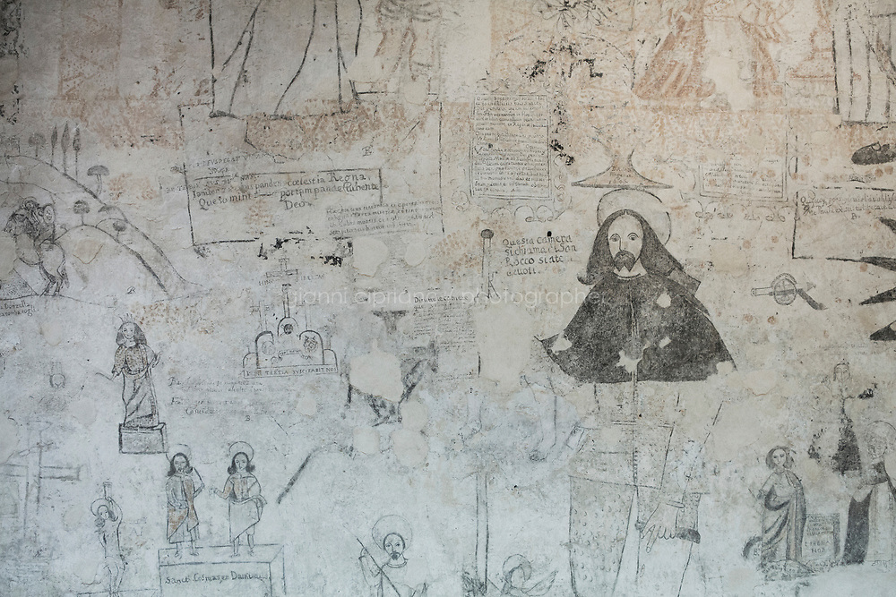 PALERMO, ITALY - 22 MARCH 2017: The walls of Palazzo Chiaramonte-Steri - today part of the University of Palermo - which between 1601 and 1782 served as the prison and tribunal of the Inquisition, preserve the anguished scratched scrawls of past inmates, including some written in Hebrew, in Palermo, Italy, on March 22nd 2017.<br /> <br /> In 1492, Sicily's Jews were banished from the island, the victims of a Spanish edict that forced thousands to leave and others to convert to Roman Catholicism. On Jan. 12, exactly 524 years to the day that the edict gave as a deadline for Sicily's Jews to depart, Palermo's archbishop, Corrado Lorefice, granted the emerging community the use of a deconsacrated oratory, to be transformed into Palermo's first stable synagogue in five centuries.  The synagogue will be located in what once was known as the Giudecca, Palermo's ancient Jewish quarter