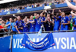 Cardiff City manager Neil Warnock and the Cardiff City players celebrate winning their promotion to the Premier League after the Sky Bet Championship match at the Cardiff City Stadium.