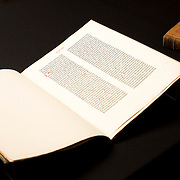 A leaf of the Gutenberg Bible printed between 1450 and 1455 sits next to  a copy of Galileo Galilei's Dialogo that survived the Inquisition in the rare book collection at the J. Willard Marriott Library on the campus of the University of Utah in Salt Lake City, Utah Wednesday Oct. 10, 2012. (Photo by August Miller)