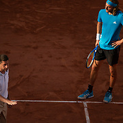 PARIS, FRANCE June 02.  Stefanos Tsitsipas of Greece discusses a line call with the umpire during his match against Stan Wawrinka of Switzerland on Court Suzanne Lenglen during the Men's Singles fourth round match on Court Philippe-Chatrier at the 2019 French Open Tennis Tournament at Roland Garros on June 2nd 2019 in Paris, France. (Photo by Tim Clayton/Corbis via Getty Images)