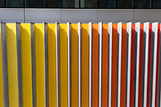 Multicoloured exterior wall which is part of an architectural design at Liverpool Street on 12th August 2020 in London, United Kingdom. Yellow, orange and red lines make up the pattern of this graphic and ordered feature of architecture.