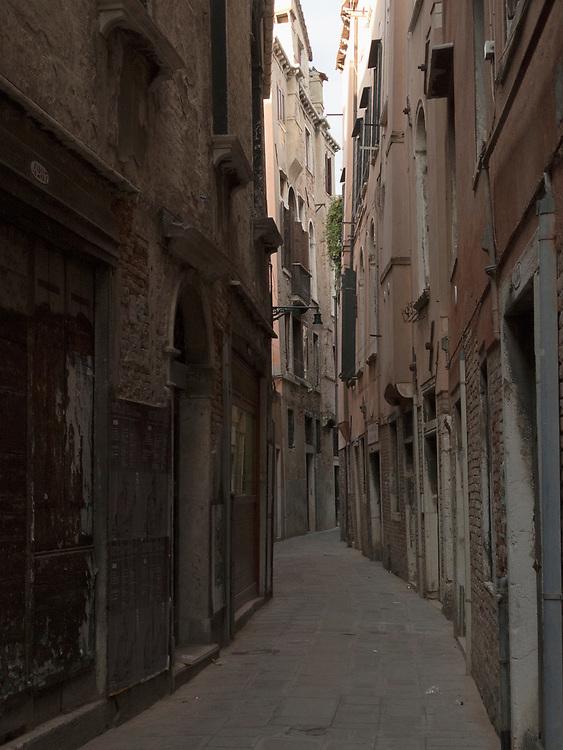 Narrow dark Venice street with no pedestrians