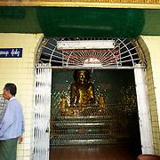 May 09, 2013 - Yangon, Myanmar: A local man passes by a shrine at Sule Pagoda in central Yangon. CREDIT: Paulo Nunes dos Santos