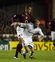 Photo: Chris Ratcliffe.<br /> Arsenal v Real Madrid. UEFA Champions League. 08/03/2006.<br /> Zinedine Zidane is tackled by Gilberto