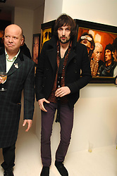 Right, SERGIO PIZZORNO of rock band Kasbian at an exhibition of artist Paul Karslake's work entitled Ideas & Idols, held at Scream, 34 Bruton Street, London W1 on 21st February 2008.<br /><br />NON EXCLUSIVE - WORLD RIGHTS