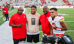 Sep 4, 2021; College Park, Maryland, USA; Maryland Terrapins quarterback Taulia Tagovailoa (3) and Maryland Terrapins head coach Mike Locksley and Maryland Terrapins co-defensive coordinator Brian Williams pose for a photo with Miami Dolphins quarterback Tua Tagovailoa after defeating the West Virginia Mountaineers at Capital One Field at Maryland Stadium. Mandatory Credit: Ben Queen-USA TODAY Sports