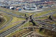Nederland, Zuid-Holland, Prins Clausplein, 04-03-2008; verkeersplein Prins Claus gezien naar Leidschenveen, Forepark met het stadion van ADO-Den Haag; Rijksweg A4 (van links boven het midden naar rechtsonder) kruist de A2, naar midden rechts richting  Zoetermeer; het knooppunt is een voorbeeld van een sterknooppunt (Maltezerkruis) en heeft vier verschillende lagen, de verschillende viaducten zijn hier uitgevoerd als fly-over; ongelijkvloerse kruising, verkeersplein, verkeersknooppunt, asfalt, weg, bedrijventerrein . .luchtfoto (toeslag); aerial photo (additional fee required); .foto Siebe Swart / photo Siebe Swart