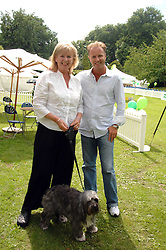 JO HANSFORD and her son DANNY HANSFORD with her dog Stella at Macmillan Dog Day in aid of Macmillan Cancer Support, held at Royal Hospital Chelsea, London on 3rd July 2007.<br />