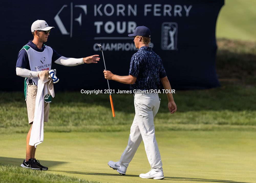 NEWBURGH, IN - SEPTEMBER 03: Nick Hardy hands his putter to his caddie on the 18th green during the second round of the Korn Ferry Tour Championship presented by United Leasing and Financing at Victoria National Golf Club on September 3, 2021 in Newburgh, Indiana. (Photo by James Gilbert/PGA TOUR via Getty Images)