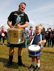 .An impromptu parade down Inveraray Main Street by some of the members of the newly crowned World Champions, Inveraray and District Pipe Band. Pipe Major Stuart Liddell and his son Alexander celebrate the victory.... (c) Stephen Lawson | Edinburgh Elite media