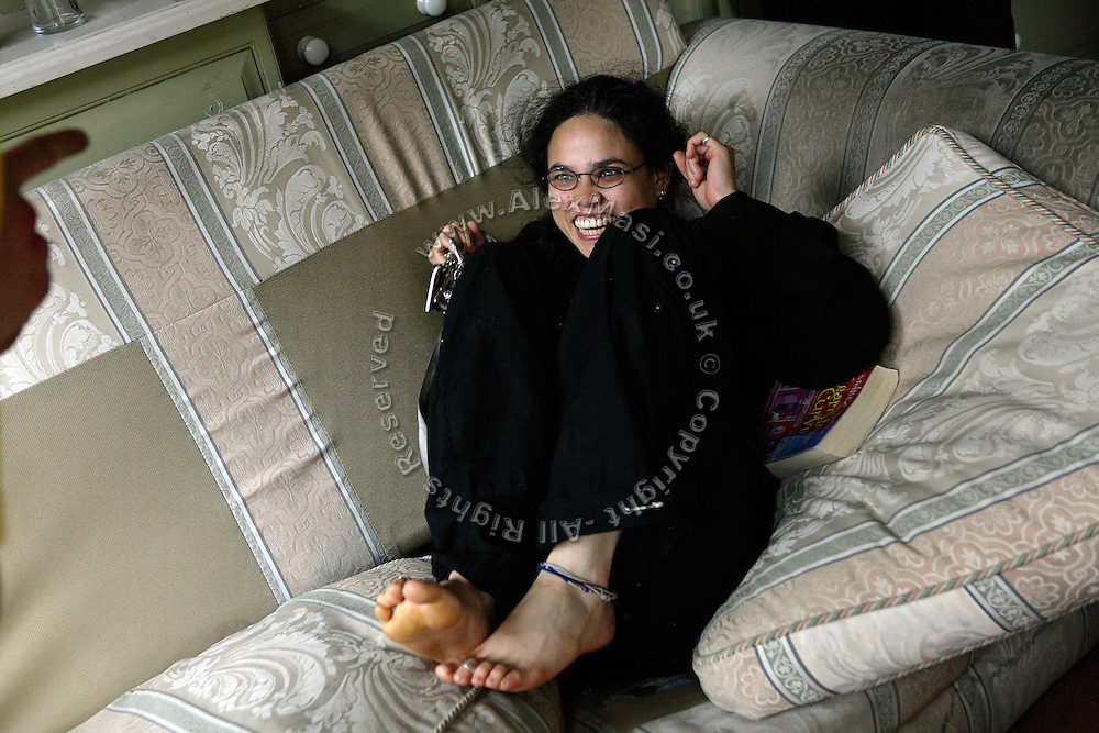 Kitty, 24, from Trinidad, is laughing on one of the sofas inside the Ingram Avenue mansion, on Saturday, Sep. 22, 2007, in Hampstead, London, England. The 22-room mansion was last sold for UK£ 3.9M in 2002 and is now awaiting planning permissions to be demolished. Two new houses will soon be taking its place. Million Dollar Squatters is a documentary project in the lives of a peculiar group of squatters residing in three multi-million mansions in one of the classiest residential neighbourhoods of London, Hampstead Garden. The squatters' enthusiasm, their constant efforts to look after what has become their home, their ingenuity and adventurous spirit have all inspired me throughout the days and nights spent at their side. Between the fantasy world of exclusive Britain and the reality of squatting in London, I have been a witness to their unique story. While more than 100.000 properties in London still lay empty to this day, squatting provides a valid, and lawful alternative to paying Europe's most expensive rent prices, as well as offering the challenge of an adventurous lifestyle in the capital.